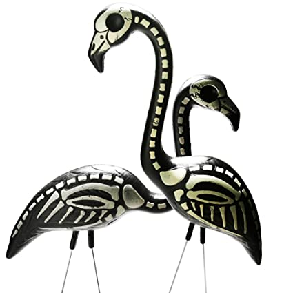 skeleton yard flamingoes