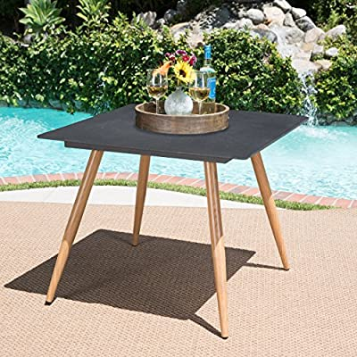 Petra Outdoor Dark Grey Square Simulated Stone Glass Dining Table with Wood Finished Metal Legs - This tempered glass outdoor Table is a great way to add something fresh to your patio The glass Table top features a stone-like appearance while the legs are made from iron with heat transferred wood, giving you the aesthetic look of wood with the durability of metal Manufactured in China - patio-tables, patio-furniture, patio - 610olOrJ2nL. SS400  -