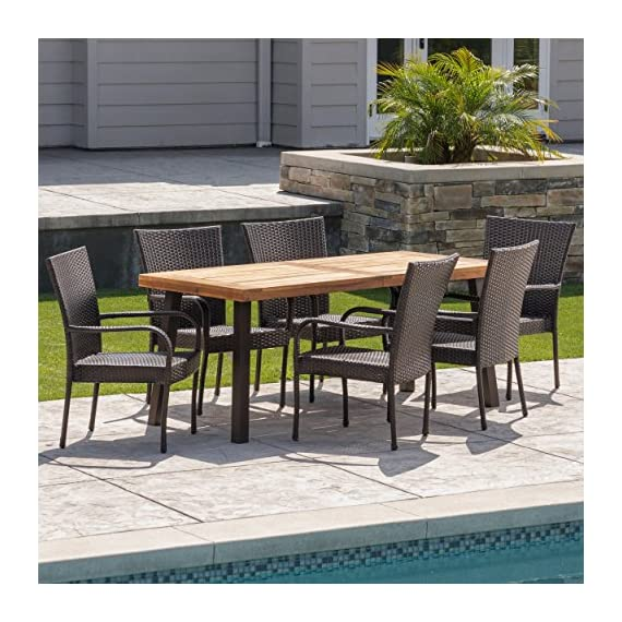Christopher Knight Home Leopold Outdoor 7-Piece Acacia Wood/Wicker Dining Set | with Teak Finish | in Multibrown, Rustic Metal - The beautiful blend of wood and wicker comes to life with this dining Set, complete with six stacking wicker dining chairs, you can enjoy eating in your backyard whenever you want, The wooden table is treated to withstand even the harshest of seasons, ensuring your Set looks great all year long, The rectangular table ensures that there is enough space for both food and people, meaning no one leaves the table hungry Includes: one (1) table and six (6) chairs Table material: Acacia wood | table leg Material: iron | chair Material: faux wicker | chair frame material: iron | table top finish: teak | table leg Finish: rustic metal | wicker finish: - patio-furniture, dining-sets-patio-funiture, patio - 610tx0sX87L. SS570  -
