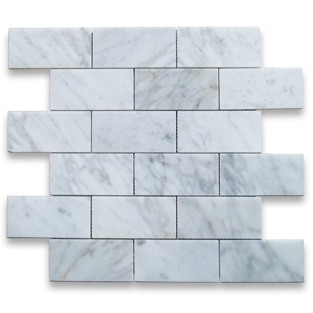 Polished carrara marble mosaic tile for kitchen backsplash. #carraramarble #marblesubway #marblemosaic #subwaymosaic #walltile #kitchendesign