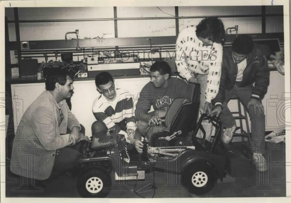 NY engineering students convert toy car into wheelchair 1989 Press Photo Troy