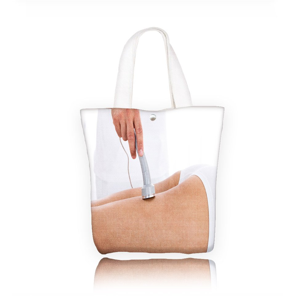 Philip C.Williams close up of a woman getting microdermabrasion therapy on her legs in spa Fashion canvas Print Tote Handbag Weekend Shopping Tote Bag