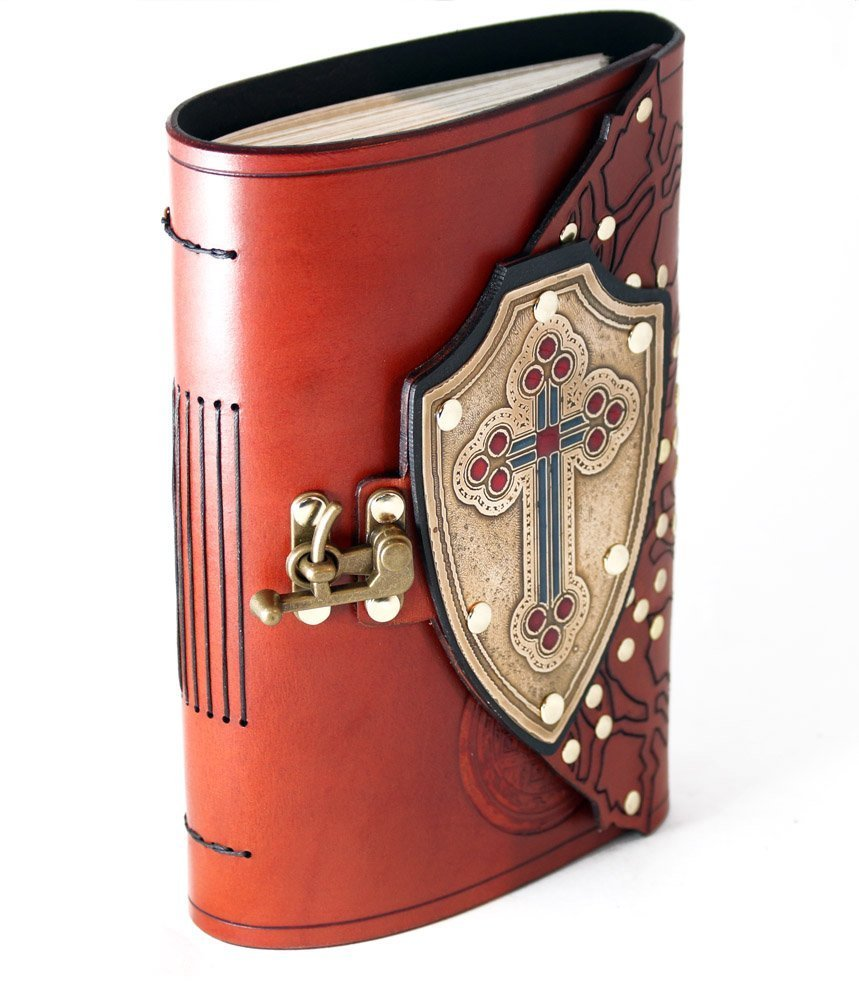 Cross shield leather bound journal with brass cross and red and blue inlay.