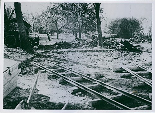 - Vintage photo of View of a ruined railway track.The Patriots have what a heap of German aviation gasoline 1944