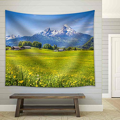Idyllic Landscape in The Alps with Fresh Green Meadows and Blooming Flowers Fabric Wall