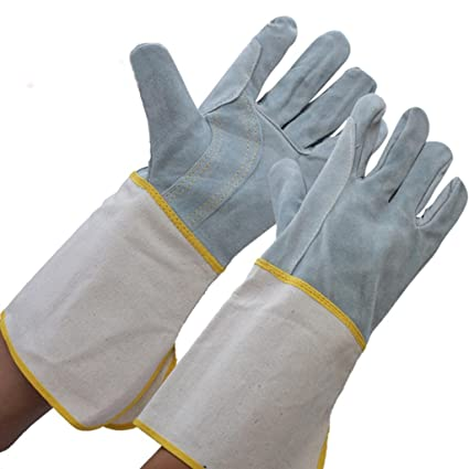 Los guantes de soldadura de manga larga de la lona de cuero ...