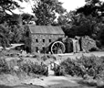 1960s People Tourists Visiting Rustic Grist Mill With Stone Structure Waterfall And Waterwheel Sudbury Massachusetts Usa