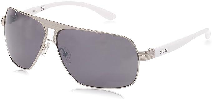 a1c84507fe0d Amazon.com  Guess Aviator Sunglasses - GU6512 10C - Shiny Dark  Nickeltin Smoke Mirror  Clothing