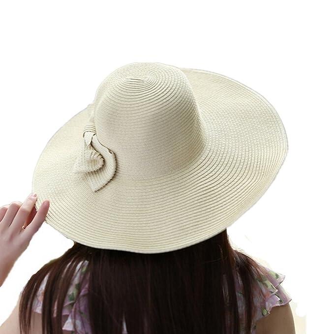 3da76800511 QianSheng Fashion Girls Women s Summer Beach Sun Visor Hat Wide Large Brim  Floppy Travel Hat Straw Hat Bucket Hats with Cute Bowknot - Beige   Amazon.co.uk  ...