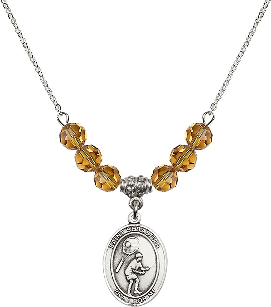 18-Inch Rhodium Plated Necklace with 6mm Topaz Birthstone Beads and Sterling Silver Saint Sebastian Tennis Charm.