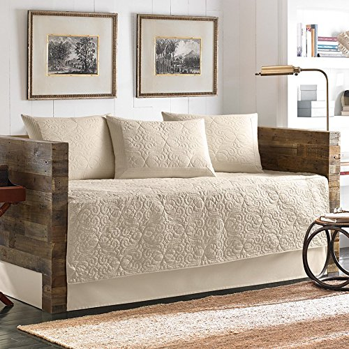 Create a vintage style bedroom with Tommy Bahama quilted bedspred