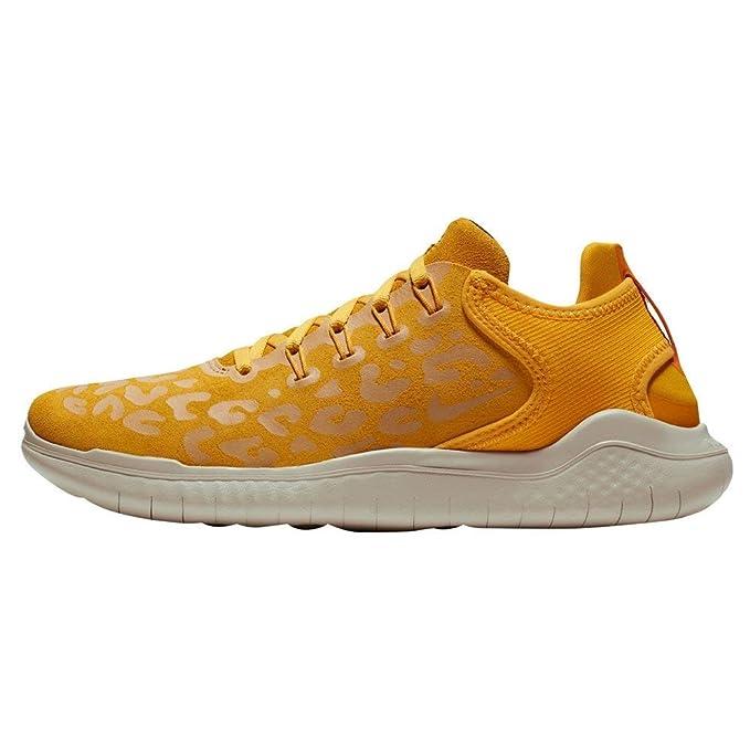 reputable site d0f8e 426b2 Amazon.com  Nike Women s Free RN 2018 Wild Velvet Running Shoe (9.5 B(M)  US, Yellow Ochre Oil Grey-University Gold)  Sports   Outdoors