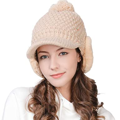 c0578f98b4c ... Winter Warm Thermal Pom Pom Hat Visor Beanie Lined with Fur Ear Warmer  Flaps Soft Acrylic Cold Weather Sports Running Hat Beige  Amazon.co.uk   Clothing