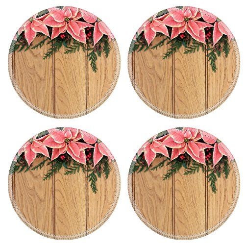 MSD Round Coasters Non-Slip Natural Rubber Desk Coasters design: 30645473 Pink poinsettia flower background border with holly and christmas greenery over oak wood