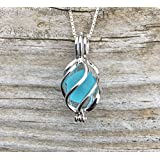 Sea Glass in Swirling Seas Locket Necklace by Wave of Life