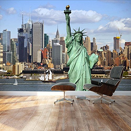 Statue of Liberty looking over the New York City skylines by the shore Landscape Wall Mural