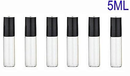 Juego de 12 botellas de vidrio vacías y translúcidas con tapa negra y bolas de metal