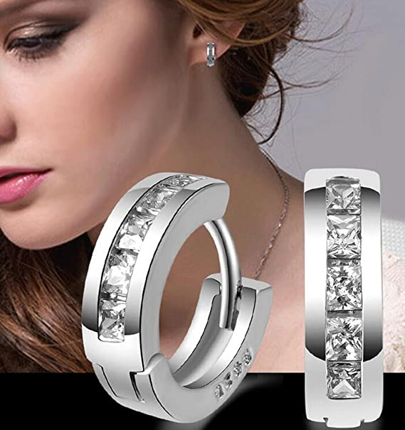 ef1d5e6c488b Xuxuou 1 par de aretes sencillos redondos de moda suizo de diamantes  pendientes de diamantes europeos aretes de plata  Amazon.es  Juguetes y  juegos