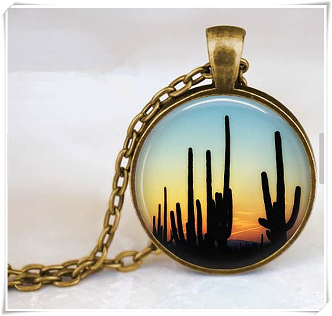 a hand stamped brass saguaro cactus pendant statement necklace with amazonite beaded chain desert sky