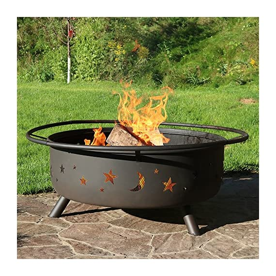 Sunnydaze Cosmic Outdoor Fire Pit - 42 Inch Large Bonfire Wood Burning Patio & Backyard Firepit for Outside with Round Spark Screen, Fireplace Poker, and Metal Grate, Celestial Design - EXTRA LARGE SIZE: Perfect to fit many people around for a bonfire in the patio, yard or garden; Overall 42 inch diameter x 23 inch high; Outdoor fire pit bowl is 10 inch tall x 34 inch diameter, weighs 36 pounds HEAVY DUTY DESIGN AND RUST RESISTANT: Deep metal firepit is made from durable thick steel construction and finished with a rustic patina colored high temperature paint for heat and rust resistance; Portable function allows the fireplace to be moved anywhere and has decorative star and moon cutouts that complements any outside style FIRE SAFETY: Includes metal round spark screen for added safety from flying sparks, built-in wood grate for better air flow, and poker tool to easily control the flame and lift the mesh screen protector - patio, outdoor-decor, fire-pits-outdoor-fireplaces - 613yNeLfi6L. SS570  -