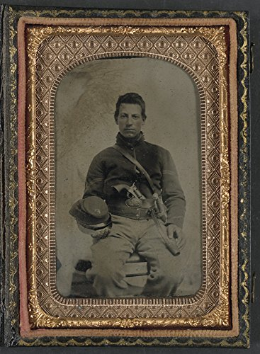 Unidentified soldier in Union uniform with Company F hat and upside down U.S. belt buckle, armed with Colt revolver and cavalry sword