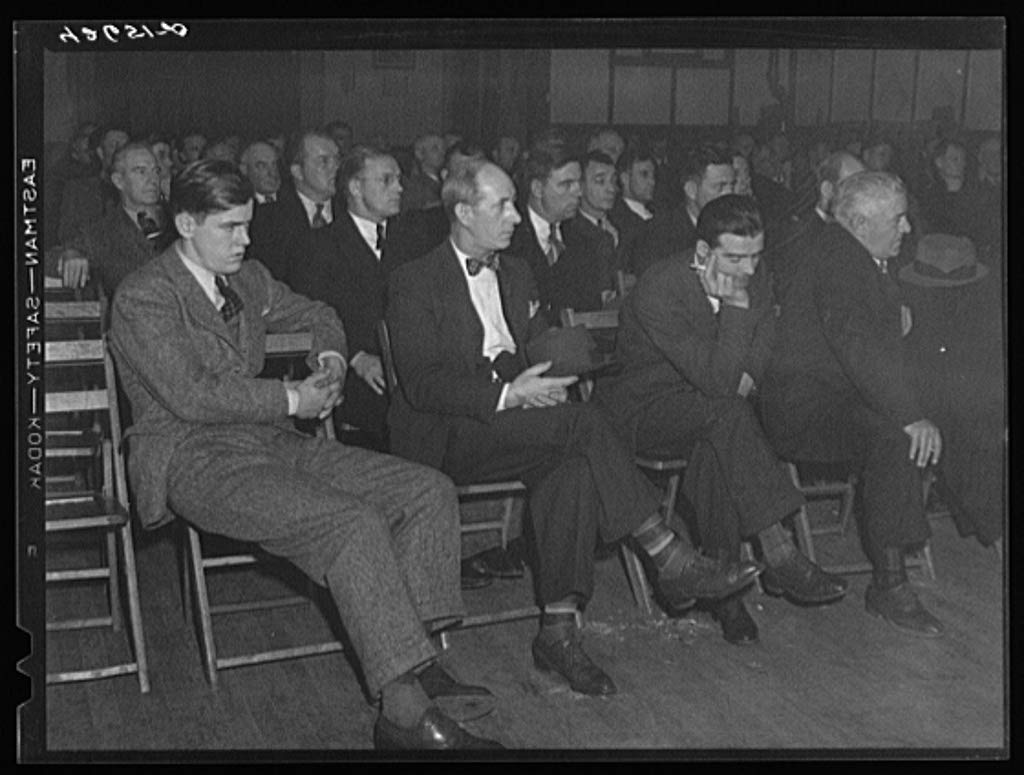 Reproduced Photo of Union meeting of Fore River shipyard workers IUMSWA-Industrial Union of Marine and Shipbuilidng Workers of America. One of the topics discussed was defense h 1940 Delano C Jack 31a