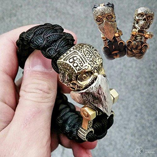 CooB 1Pcs/Lot Paracord Bracelet Knife Lanyard Brass Bead/Bead/Lock/Buckle - Terminator - Optimus - Gladiator - Wow - Hobbit Sauron - Predator + Free Lucky Dice Bead (Lock Skull) (Skull Buckle Metal)