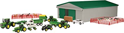 Amazon Com Tomy John Deere Die Cast Farm Toy 70 Piece Value Playset With Machine Shed Tractors Trucks Implements And Farm Animals Toys Games