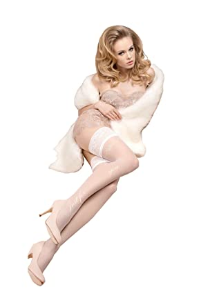 17ada5df4 Sexy White hold ups floral pattern at top of right leg lace trim features  at the ...
