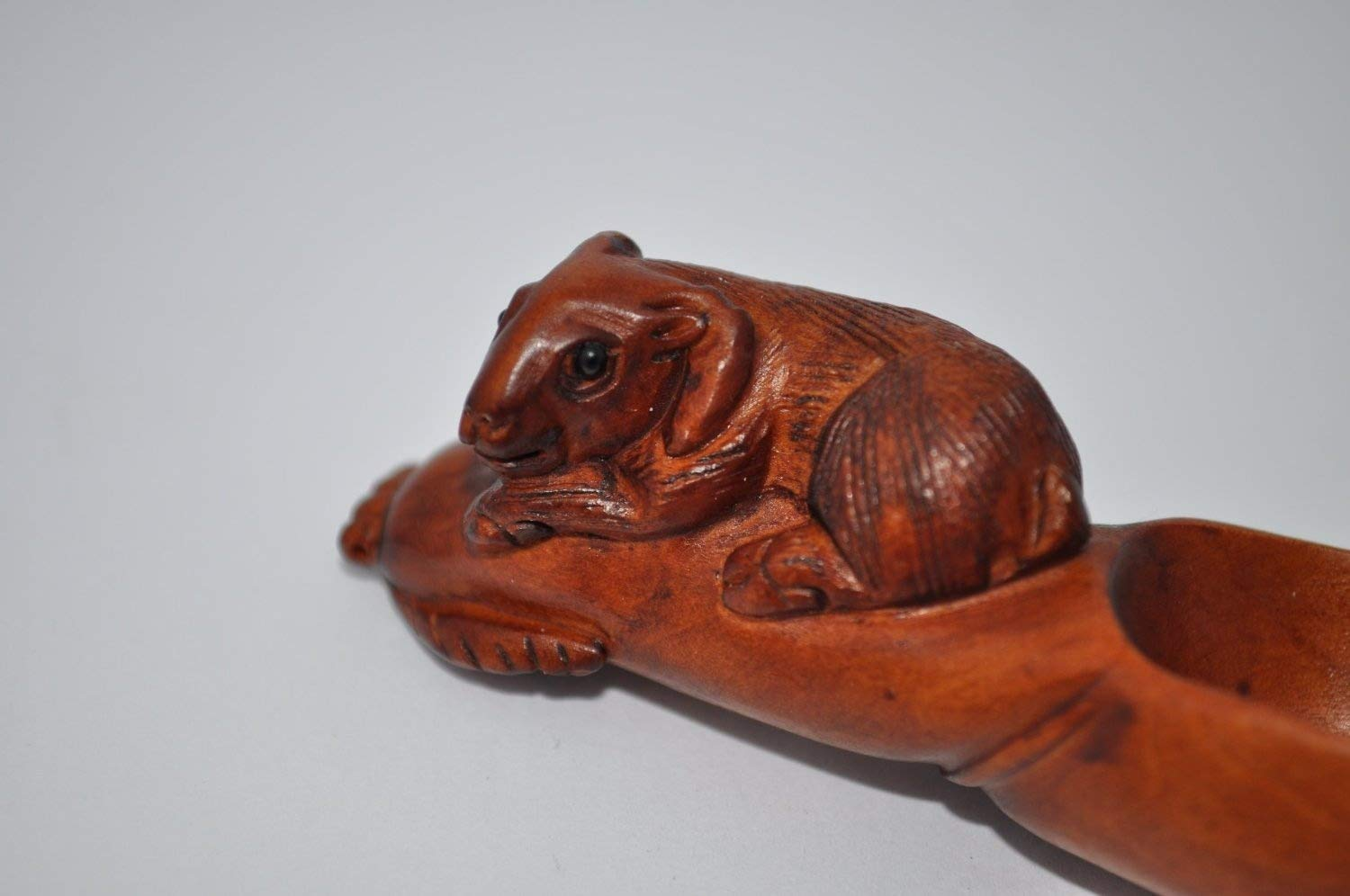 Boxwood tea scoop with a Goat carved on the handle