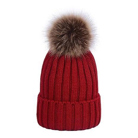 Lau s Bambini cappelli caldi di maglia ragazzo cappello pon pon pelliccia  staccabili bianco  Amazon.it  Abbigliamento 48520963f48d