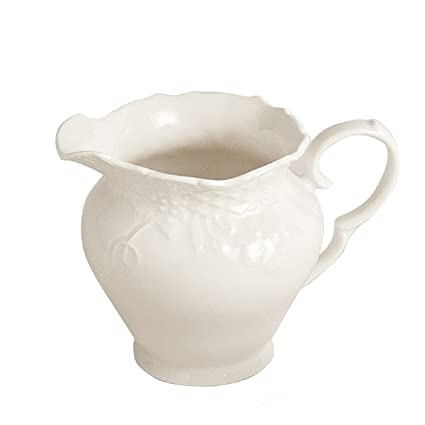 Colección hervit; tetera, tazas de te, tazas de café, platos decorativos,