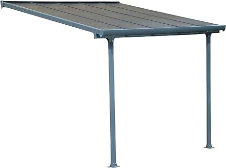 Pergola addossata con estructura de aluminio y cubierta de policarbonato alveolado transparente de 8 mm.
