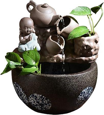 Fuentes decorativas Fuente de escritorio Pequeño monje y tetera inclinable natural Decoración de escritorio y atomizador Humidificador Fuente interior Cultura de Buda Estanques y jardines de agua: Amazon.es: Hogar