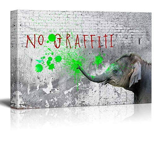 Little Naughty Elephant Spraying Green Paints on a Wall with No Graffiti Warning