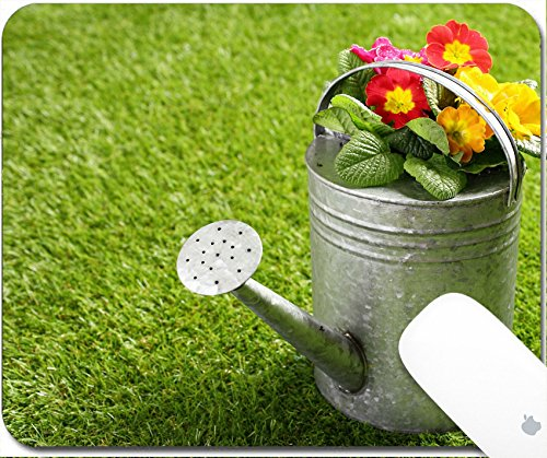 Luxlady Gaming Mousepad 9.25in X 7.25in IMAGE: 20281089 Galvanised metal watering can filled with colourful orange summer flowers standing on a neat green lawn with ()