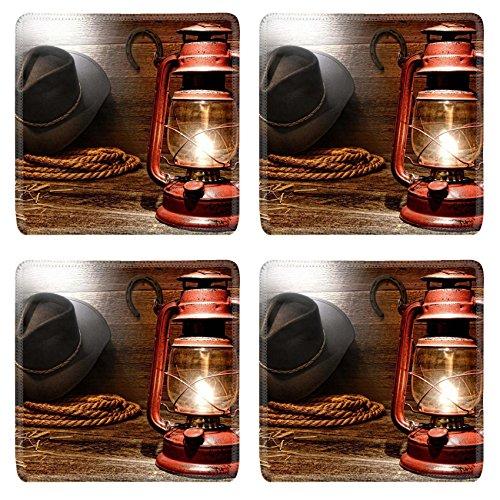 Liili Square Coasters Non-Slip Natural Rubber Desk Pads IMAGE ID: 15544339 Vintage kerosene lantern lamp illuminating American West rodeo cowboy gear with hat