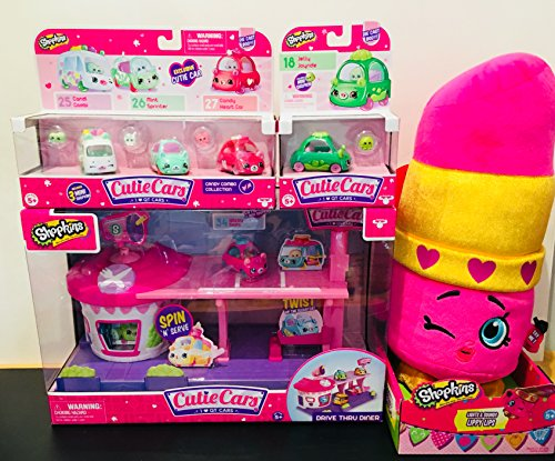 Deluxe Shopkins Cutie Cars Gift Set - Cutie Cars Drive Thru Playset with Exclusive Car + 3-pack Candy Combo + Single Diecast - Jelly Joyride + Lights & Sounds Lippy Lips Plush Toy - Exclusive Playset Light