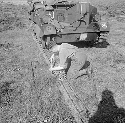 The British Army in the United Kingdom 1939-45 Fixing the track of a Universal or 'Bren gun' (Universal Bren Carrier)