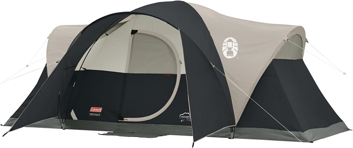 This is a photo of a tent in black and beige color, rainfly attached on it with ropes supporting the tent.
