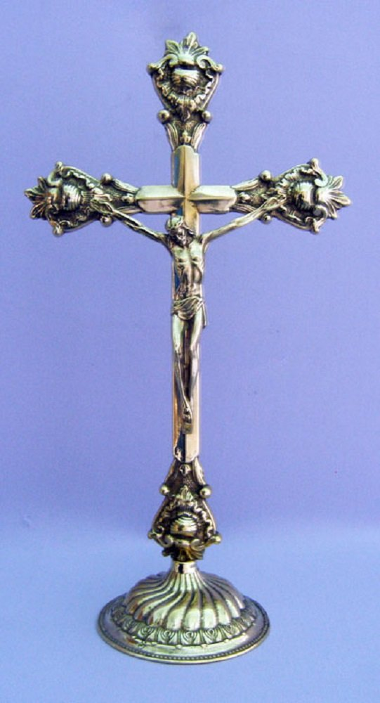A standing Crucifix in shiny brass, 14.5inches . Made in Italy.