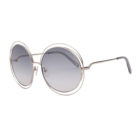 b9ad8087041 Chloe CE114S-734 Ladies Carlina Gold Transparent Light Grey CE114S  Sunglasses at Amazon Women s Clothing store