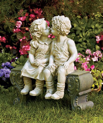 Boy & Girl Sitting on Bench Kissing Statue