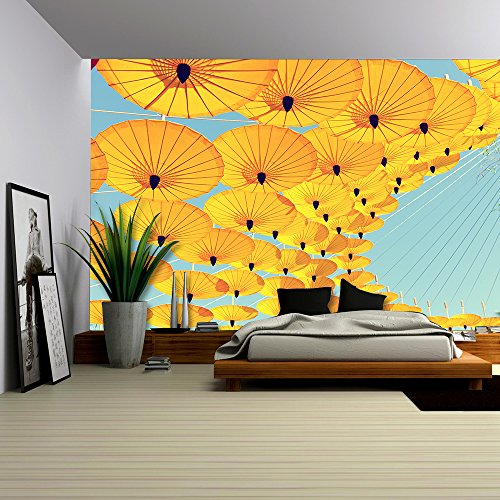 by Colorful Umbrella with Sky Background
