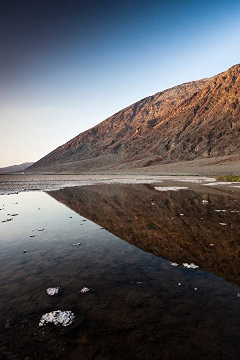 amazon com reflection of rock on water western hemisphere badwater