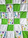 Colorful laughing giraffes peeking around green and polka dot squares.