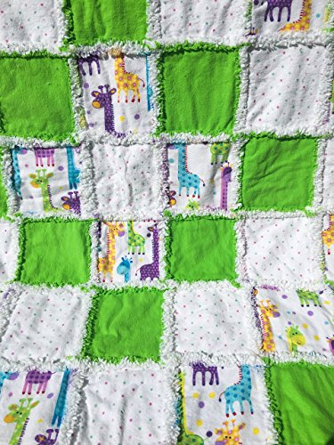 Colorful laughing giraffes peeking around green and polka dot squares. by Laughing Heart Designs
