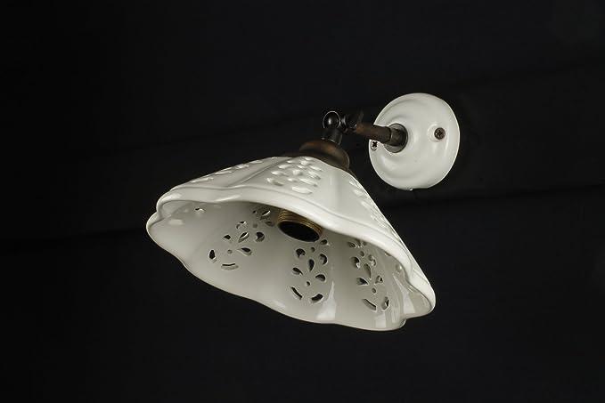 Applique in ceramica traforata rustica con luce orientabile: amazon