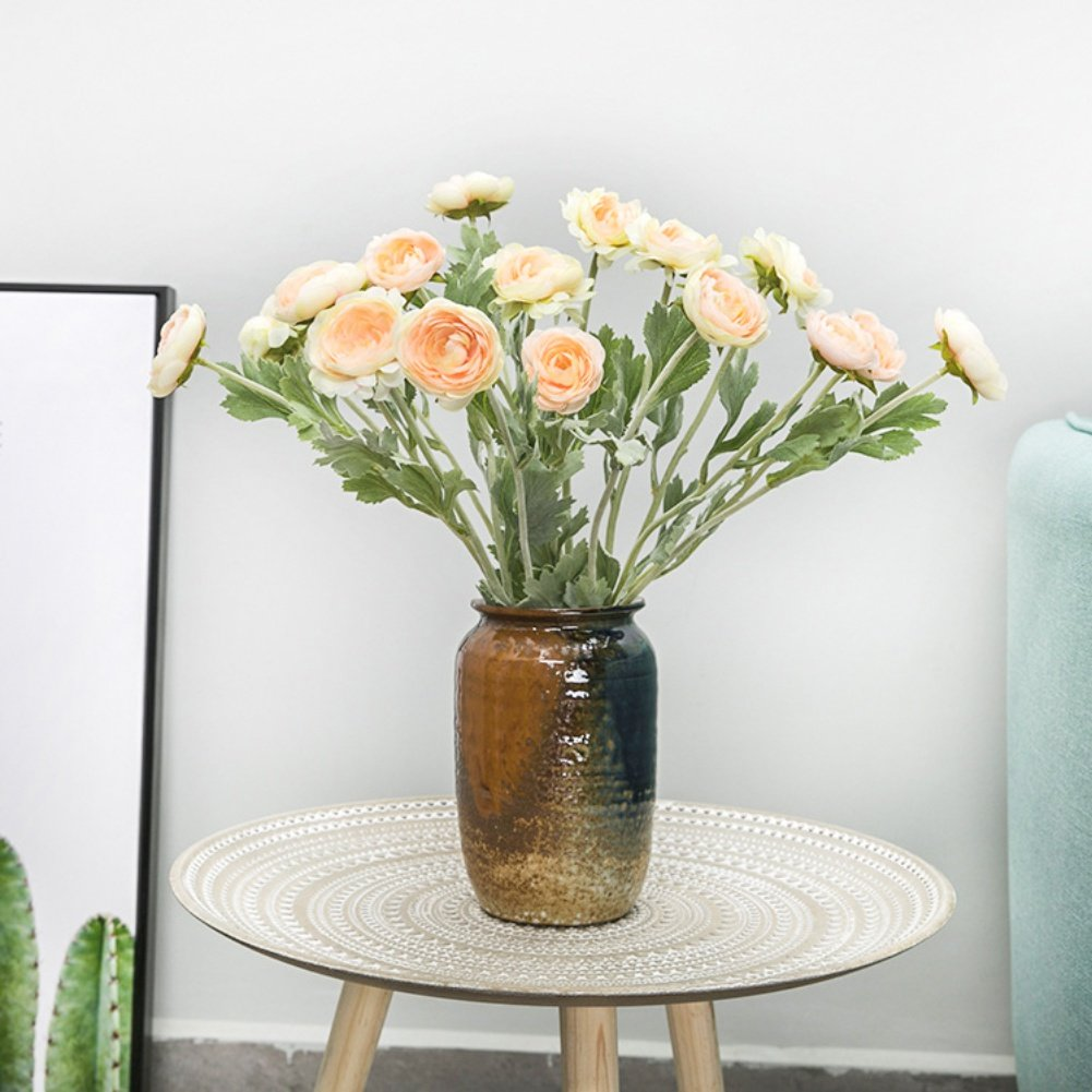 peach ranunculas vase table