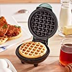 """Dash Mini Maker: The Mini Waffle Maker Machine for Individual Waffles, Paninis, Hash browns, & other on the go Breakfast, Lunch, or Snacks 8 MORE THAN WAFFLES: Make paninis, hash browns, and even biscuit pizzas! Any wet batter will """"waffle"""" your treats and snacks into single serving portions. Great for kids or on the go! COMPACT + LIGHTWEIGHT: Weighing 1lb+, this is a MUST-HAVE for that first apartment, smaller kitchen, college dorm life, or camper/RV traveling QUICK + EASY: Simply plug it in and go; it heats up in mere minutes. The dual non-stick surfaces provide an even cook for consistent results, each and every time"""